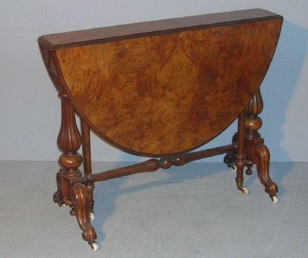 9: 19th century walnut oval sutherland table on