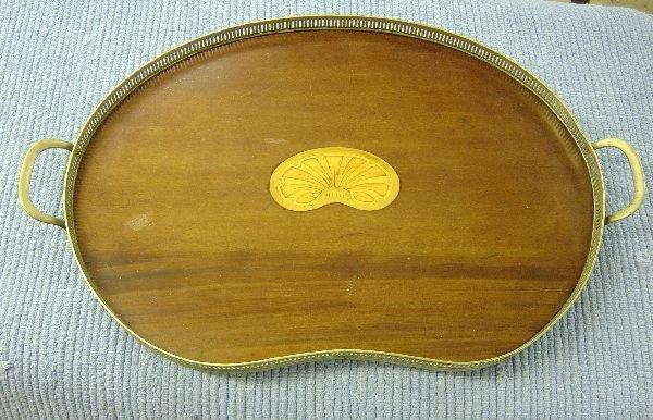 17: Mahogany kidney shaped tray with metal