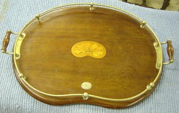18: Mahogany kidney shaped tray with central