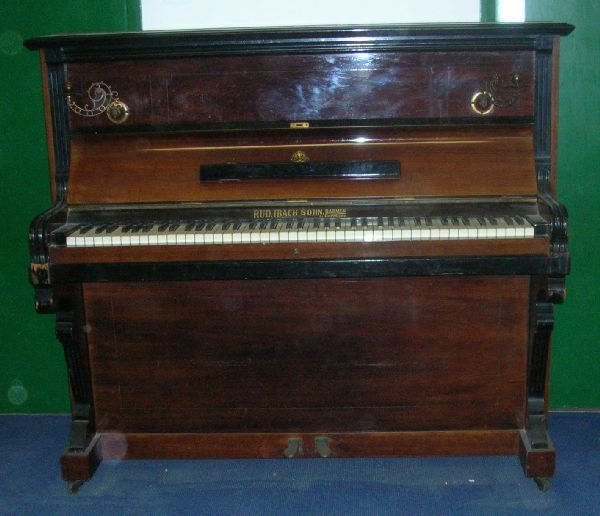 26: Walnut upright piano by  Rud. Ibach Sohn.