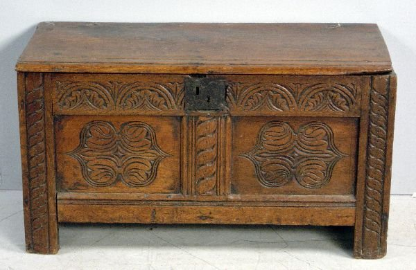 14: 18th century oak coffer, the panelled front with ar