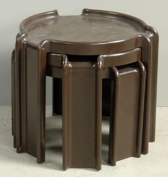 16: Nest of three brown plastic round tables designed b