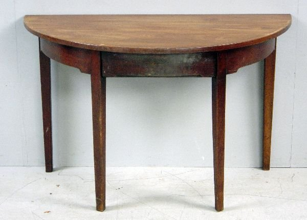 19: The D-end of a George III mahogany dining table wit