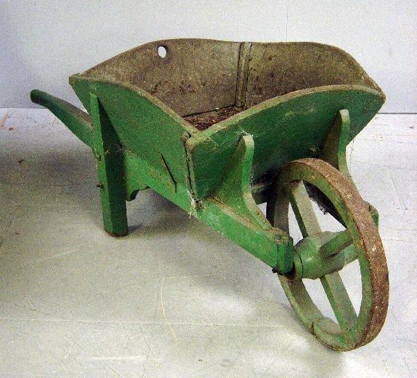 26: Green painted garden wheelbarrow