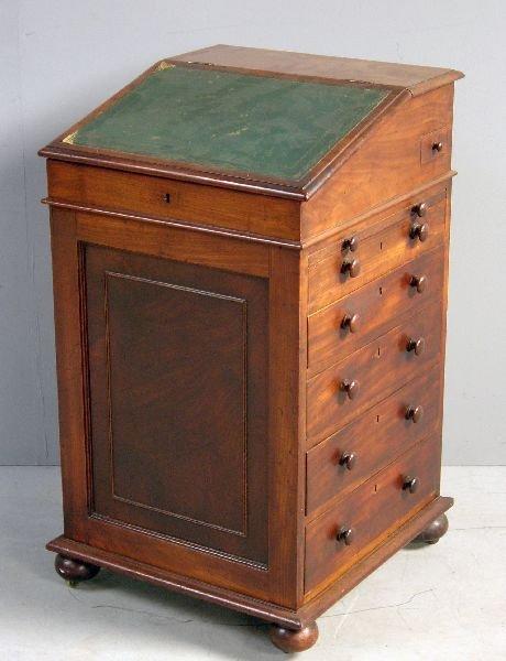 27: Early 19th century mahogany davenport with sliding
