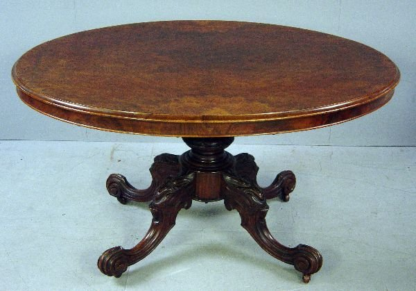 30: 19th century walnut oval breakfast table on carved