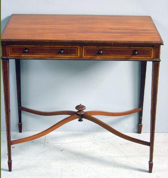 31: Late 19th century mahogany table with boxwood and e