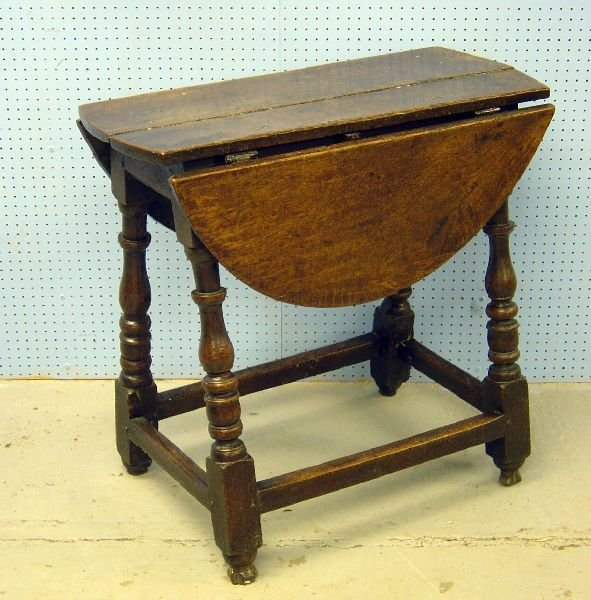 79: 17th century oak oval gateleg dining table on turne