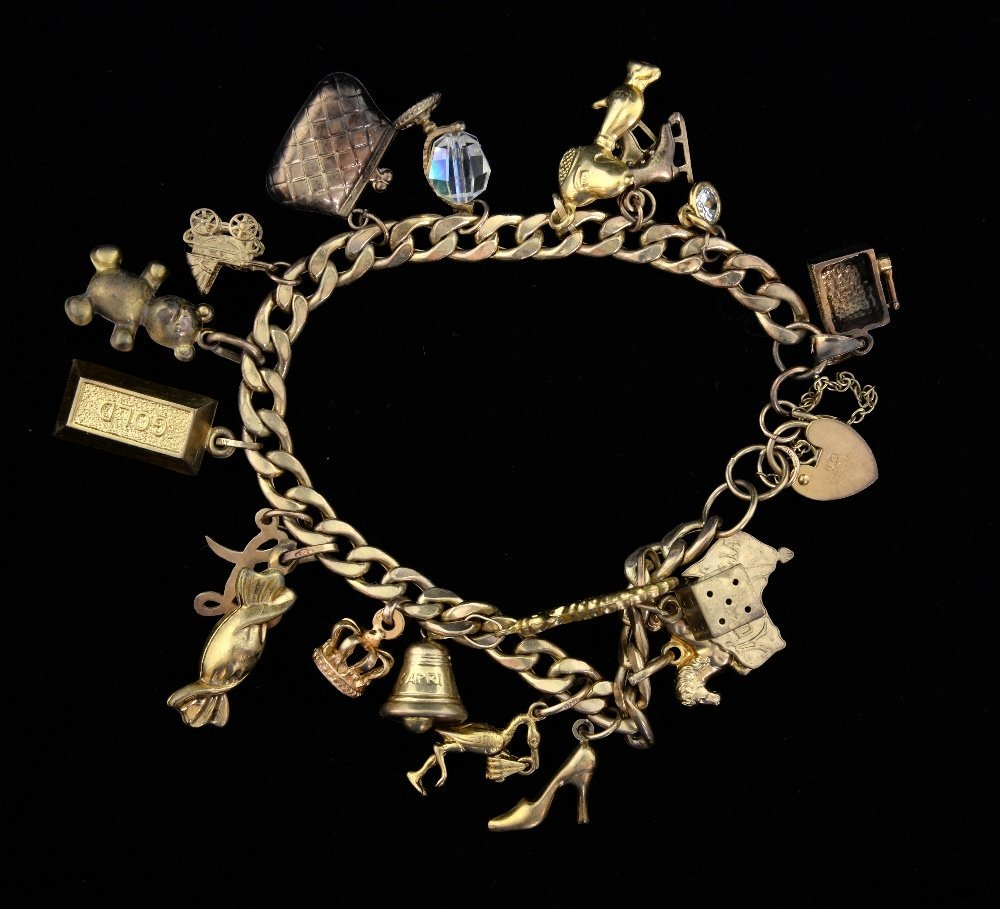 Gold charm bracelet, with a variety of c