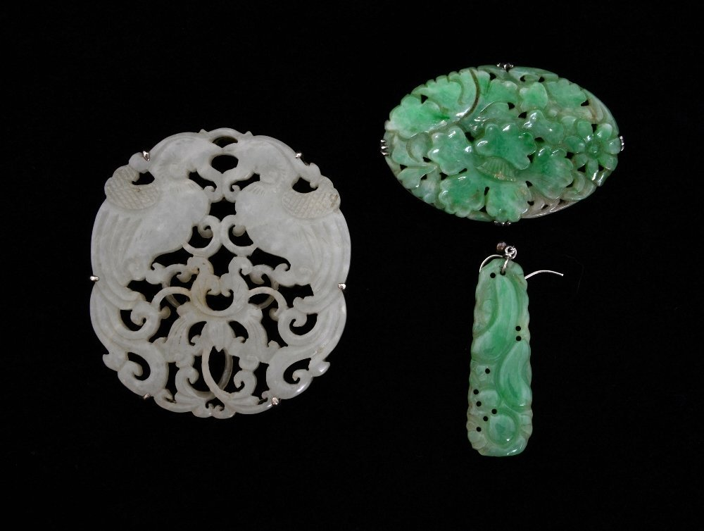 Two jade brooches, green fade oval carve
