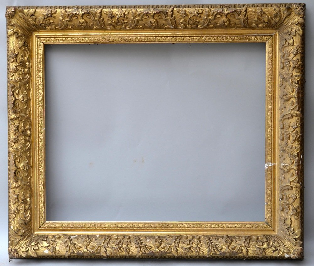 Gilt wood and gesso picture frame with scrolling f