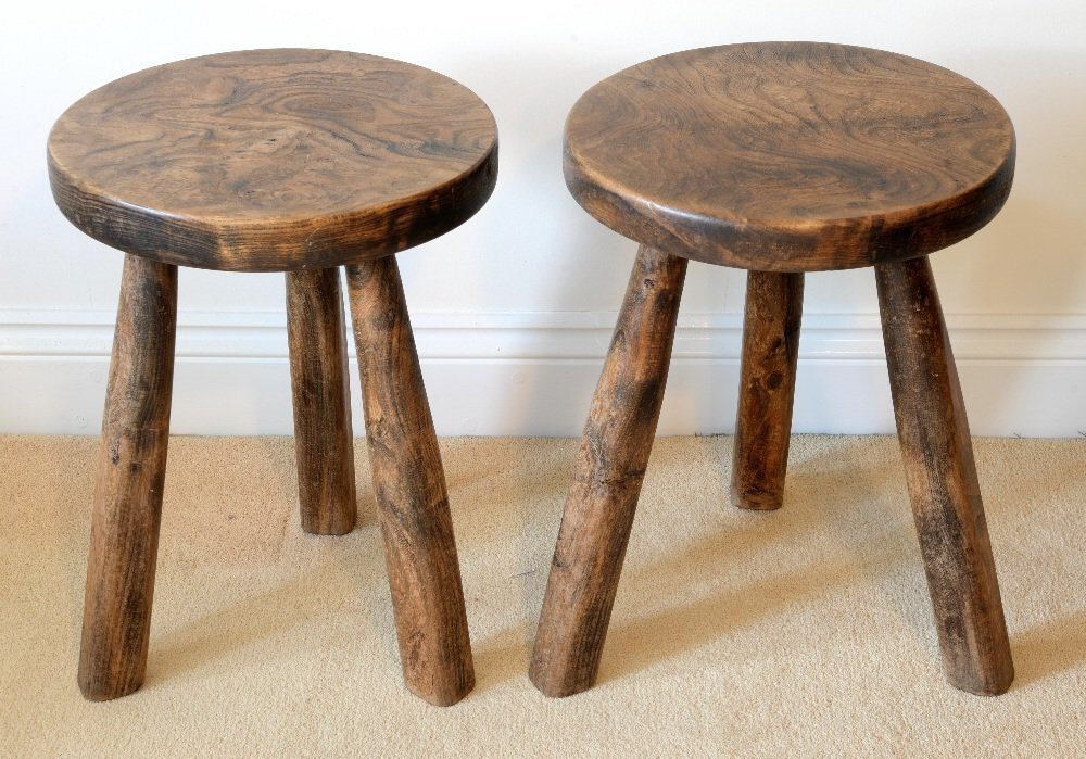 Pair of walnut rustic style stools, each on three