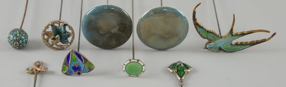 A small collection of hat pins including Ruskin, an
