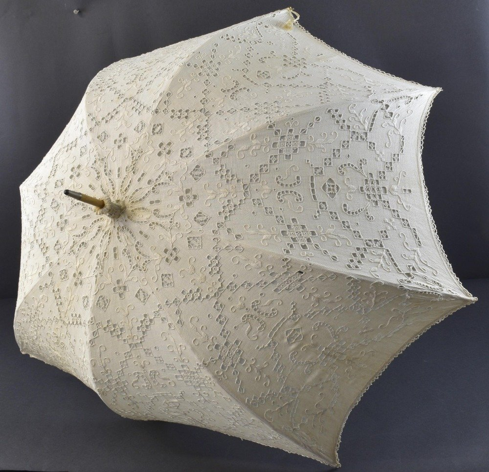 Two parasols, one with black Maltese lace on grey silk,