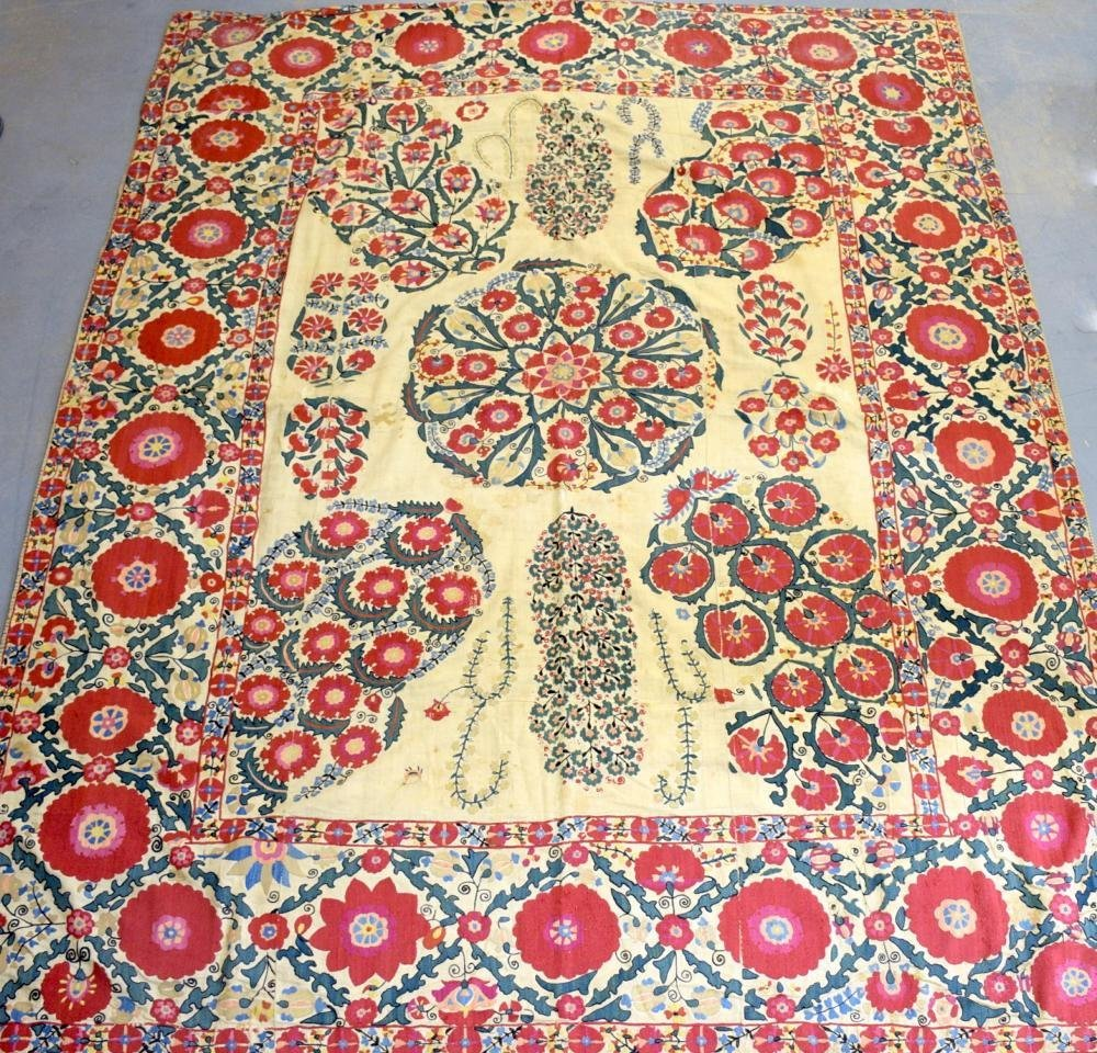 A large Suzani, Turkistan 18/  early 19th C , formal