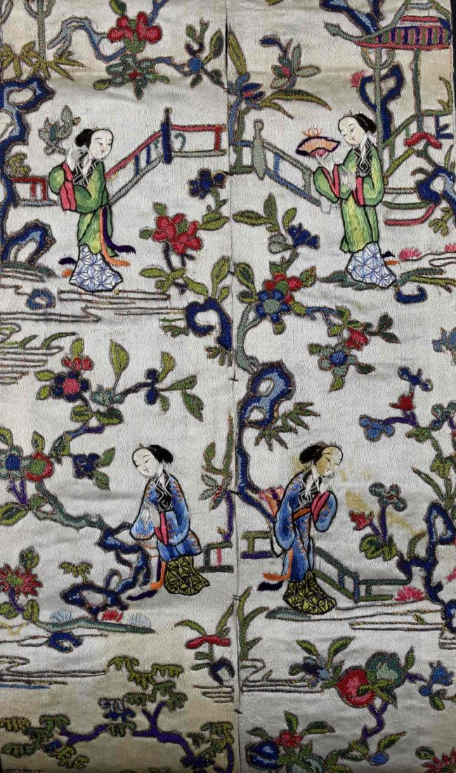 A pair of Chinese sleeve panels, finely worked in
