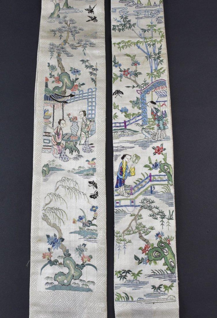 A pair of Chinese sleeve panels embroidered on cream