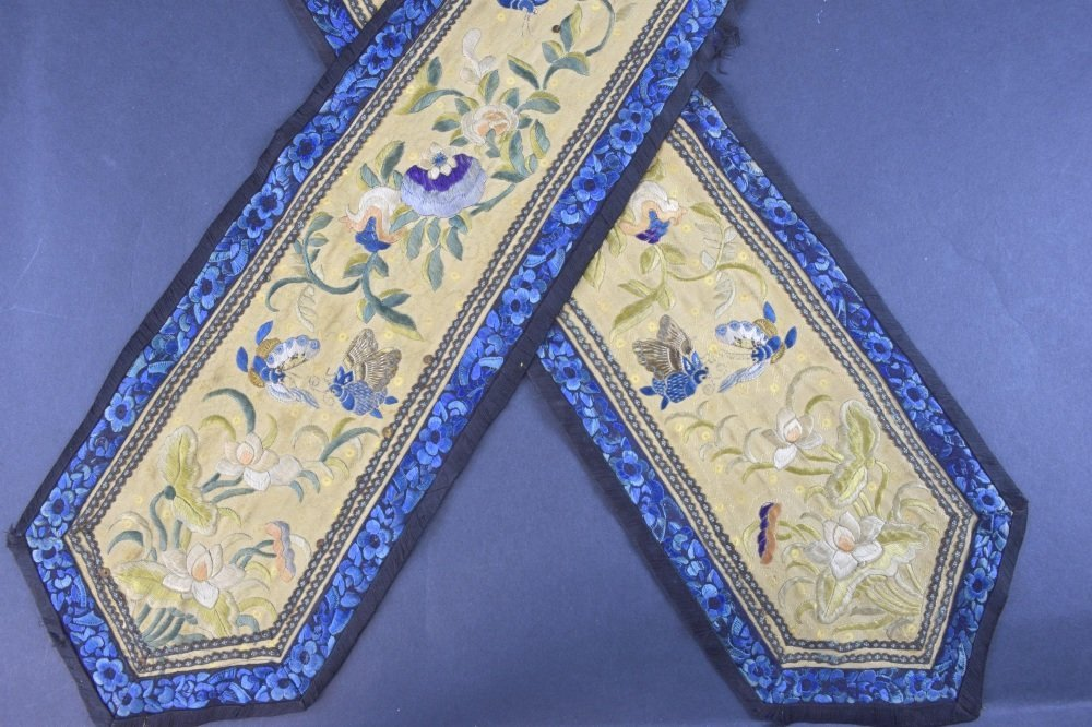 Chinese embroidered panels, on gold silk with design of