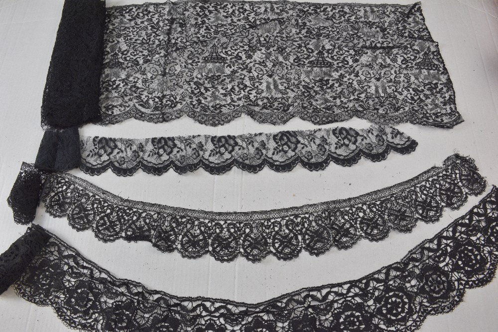Lengths of black chantilly and other European lace