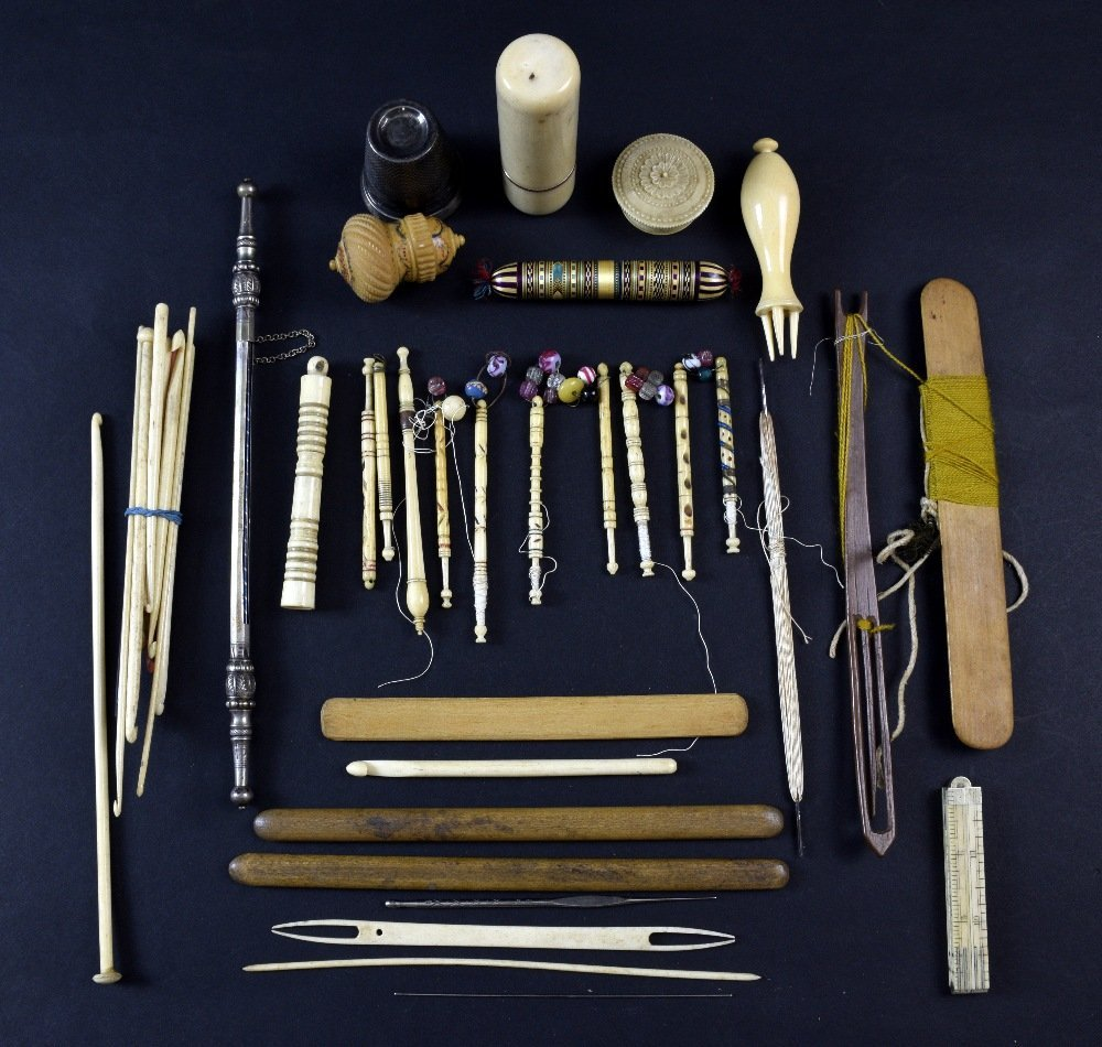 Collection of sewing implements including eight lace