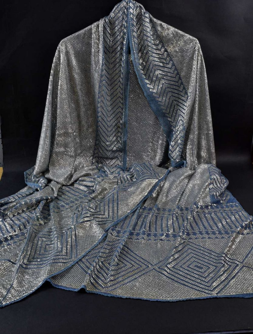 An Art Deco Assuit  shawl of silver thread on blue net