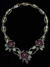A fine enamel and gemset flower necklace, ruby set