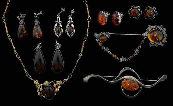 A collection of amber jewellery, mainly silver