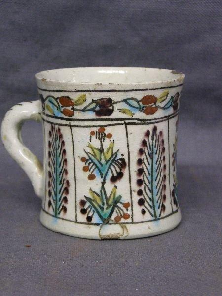 458: glazed mug decorated in polychrome glazes