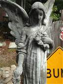Huge Stone Statue Of Angel With Flowers