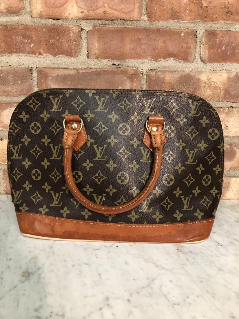 """Louis Vuitton """"Alma"""" Handbag"""