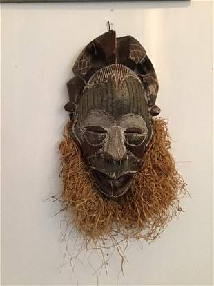 African Mask with metal trim and straw beard