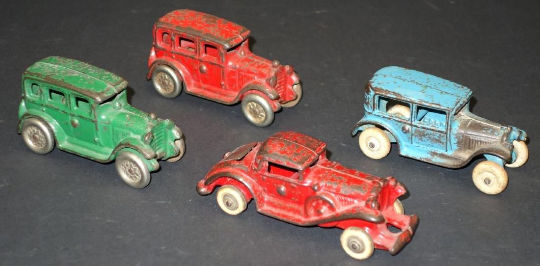TOY AUTOMOBILES (4)