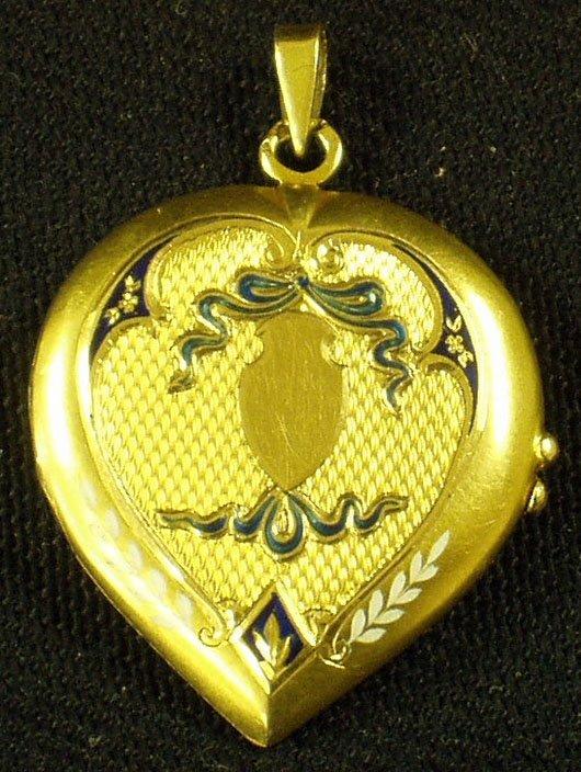 24: GOLD AND ENAMEL HEART SHAPED LOCKET