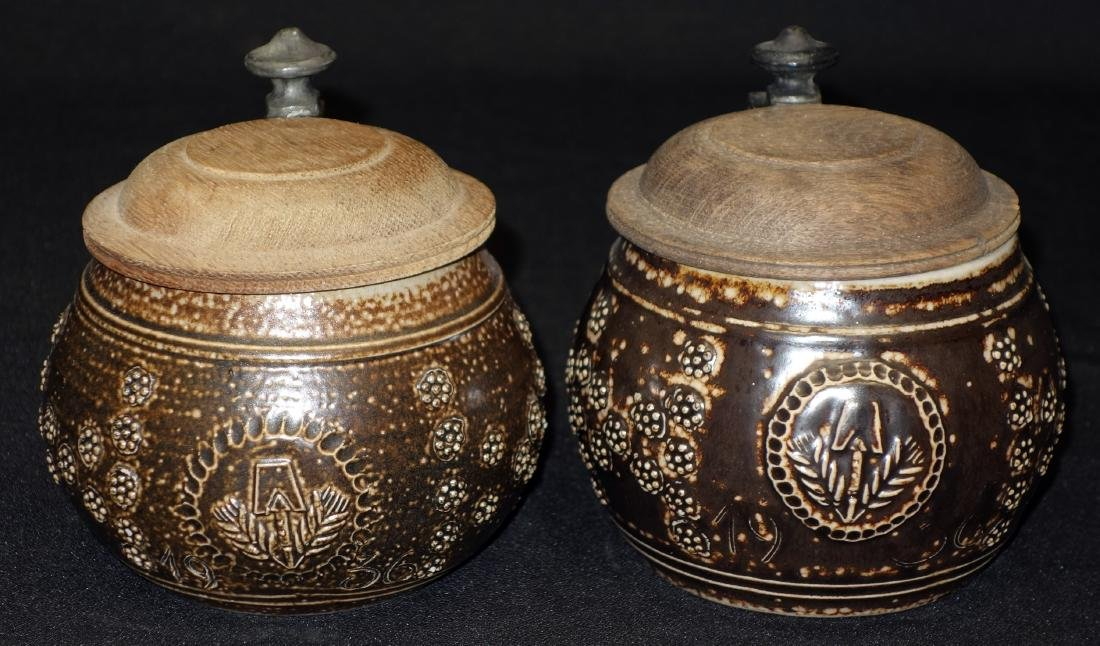 BROWN STONEWARE STEINS (2)