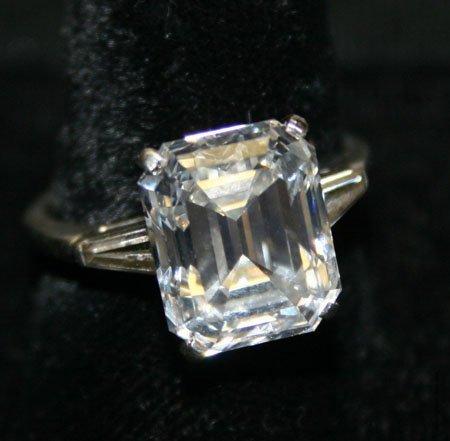 77: 8 CARAT EMERALD CUT DIAMOND RING