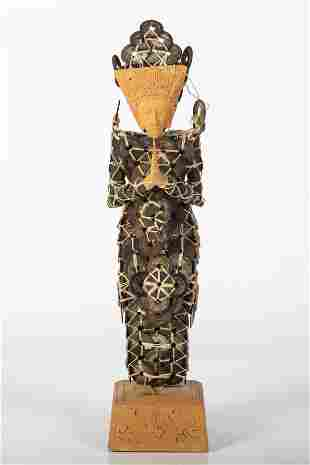 ASIAN COIN-ORNAMENTED FIGURE