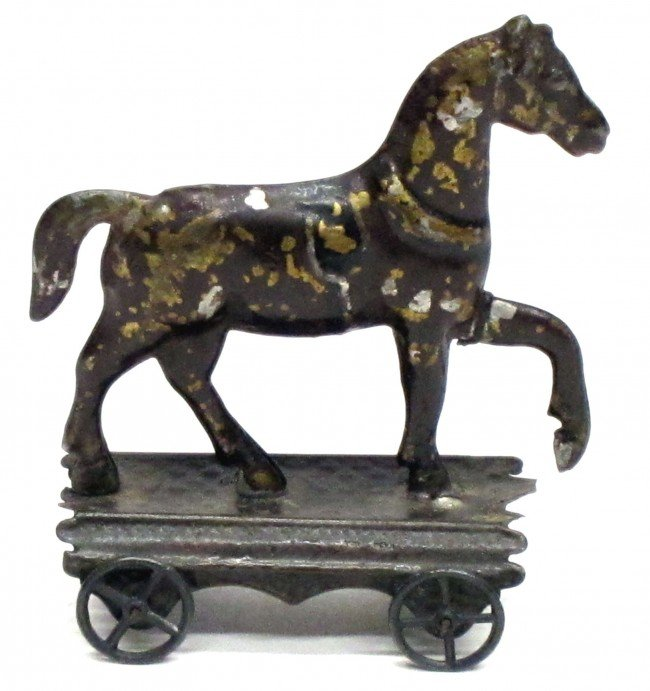77: EARLY AMERICAN TIN HORSE TOY
