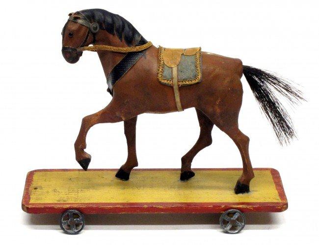 79: PLATFORM HORSE TOY