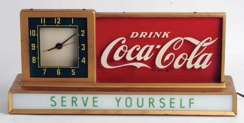 556: 1950's Coca-Cola lightup counter clock