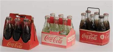 421 3  COCACOLA MINIATURE 6PACK CARTONS  BOTTLES