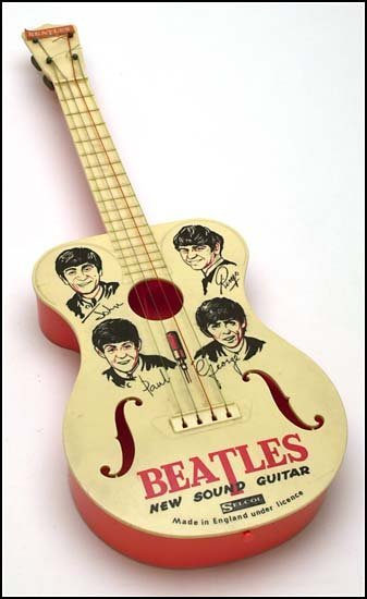 2910: c.1960s BEATLES SELCOL TOY GUITAR