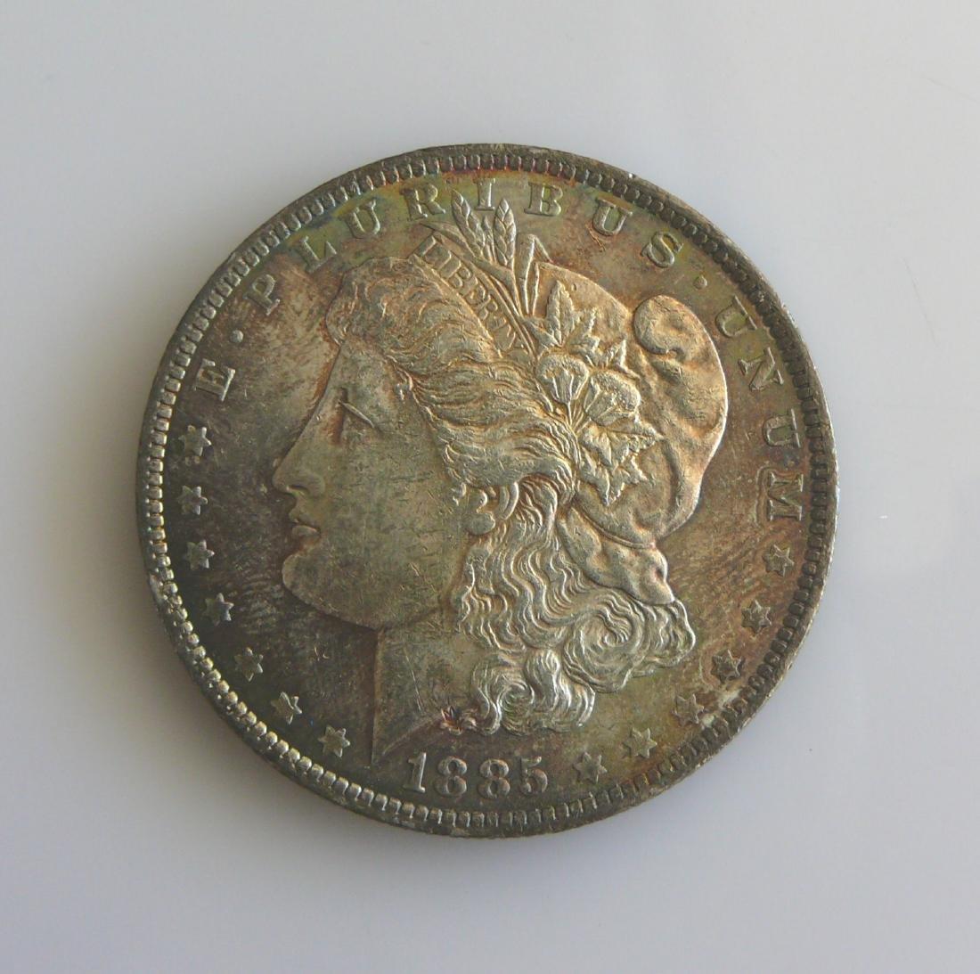 1885 O Gem Uncirculated Rainbow Toned Morgan Silver
