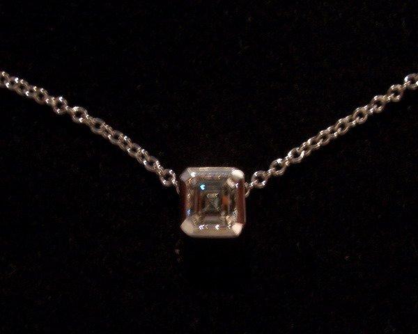 11: Diamond Pendent  0.60tcw (G color VS1 clarity )