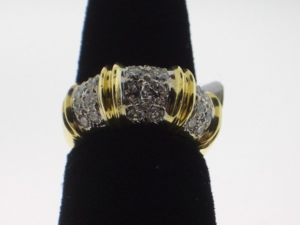 109: Tiffany style Diamond and Gold Ring