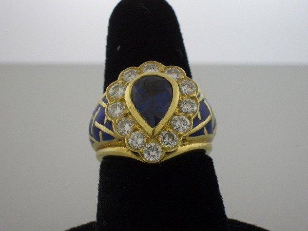 125: Diamond/Sapphire/ yellow gold ring