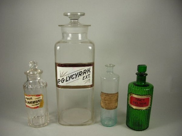 22: 4 Apothecary Bottles Incl Green Poison Bottle