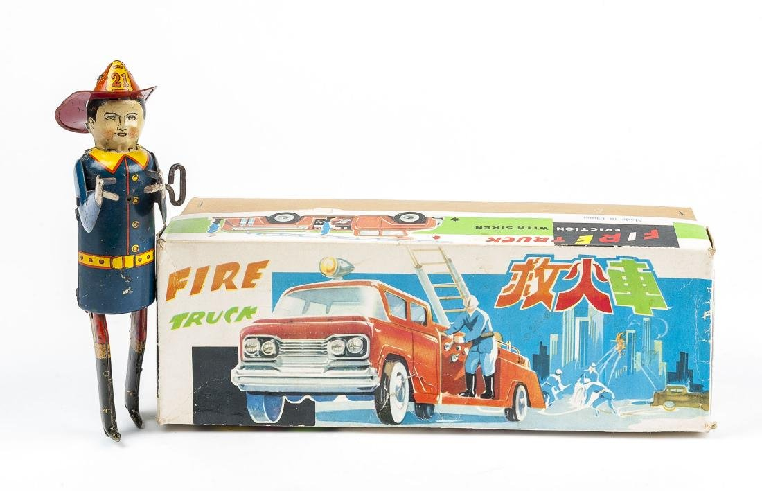 2 Tin Toys Incl Louis Marx Climbing Fireman