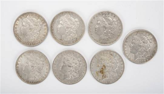 7 Morgan Silver Dollars