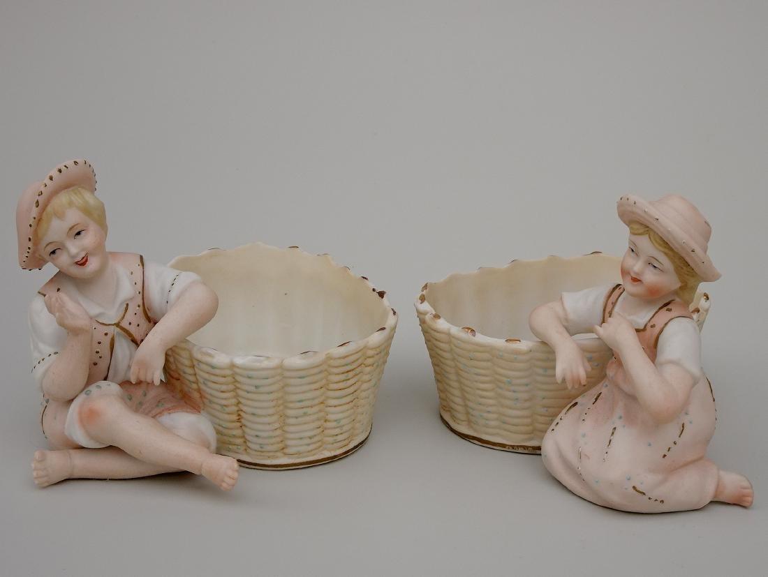 Vintage Bisque Porcelain Figurines Children next to