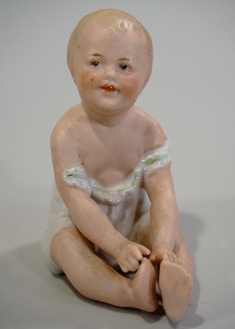 Piano Baby German Antique Bisque Porcelain Figurine
